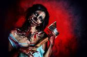 pic of bloody  - Scary bloody zombie girl with an ax - JPG