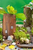 foto of fairy-mushroom  - Little fairy house with colorful mushrooms in a green forest - JPG