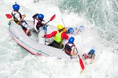 foto of raft  - White water Rafting as extreme and fun sport  - JPG