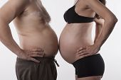 stock photo of nudity  - pregnant woman and fat man top nude on white background - JPG