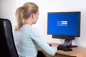 stock photo of social system  - back view of woman with personal computer using email or social network in office - JPG