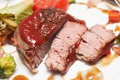 picture of chateaubriand  - Tenderloin steak with steamed vegetables - cut in pieces ** Note: Shallow depth of field - JPG