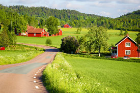 image of farm landscape  - old red farm houses set in a rural landscape and nature - JPG