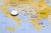 stock photo of crisis  - One Euro coin on a Europe map - JPG
