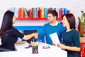 pic of negotiating  - satisfied clients couple after successful business negotiations in office - JPG