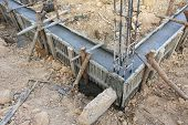 stock photo of reinforcing  - construction house reinforcement metal framework for concrete pouring - JPG