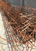 image of reinforcing  - Steel rods used to reinforce concrete in construction site - JPG