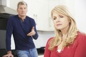 stock photo of mature men  - Mature Couple Having An Arguement At Home - JPG