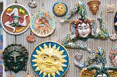 stock photo of keepsake  - Detailed view of some typical and coloured souvenirs of Sicily along the streets of the town - JPG