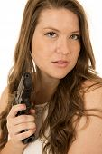 picture of pistols  - Woman with serious expression pointing black pistol - JPG