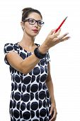 foto of ballpoint  - Portrait of Serious Woman with Eyeglasses Wearing a Printed Dress Holding a Red Ballpoint Pen - JPG
