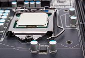 pic of processor socket  - CPU socket on motherboard with installed a processor - JPG
