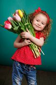 ������, ������: Beautiful little girl with a big bouquet of tulips