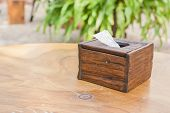 image of tissue box  - Wooden vintage tissue box on the wood table in shallow depth of field - JPG