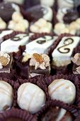 foto of irresistible  - Mixed cakes with white cream and chocolate - JPG