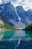 stock photo of ten  - three of the ten peaks are visible here in the valley of ten peaks which form the backdrop of moraine lake in banff national park alberta canada - JPG