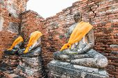 stock photo of gautama buddha  - Broken Buddha the ancient city of Thailand with ancient architecture style - JPG