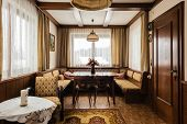 stock photo of chalet interior  - Interior of an austrian house with old retro furniture ready for renovation - JPG