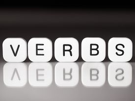 stock photo of verbs  - Verbs concept with letters on white tiles - JPG