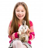 picture of rabbit year  - cute smiling girl in a crimson sweater  with baby rabbit isolated over white close - JPG