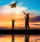 foto of kites  - Dad and daughter flying a kite on the beach - JPG
