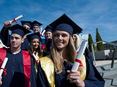 pic of graduation  - young graduates students group  standing in front of university building on graduation day - JPG