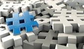 picture of hashtag  - A concept image showing a scattered collection of white hashtags and a single blue one on an isolated studio background - JPG