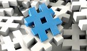 stock photo of hashtag  - A concept image showing a scattered collection of white hashtags and a single blue one on an isolated studio background - JPG