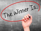 image of winner  - Man Hand writing The Winner Is - JPG