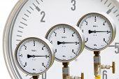 image of air pressure gauge  - High pressure reading on gas wellhead isolated on white - JPG