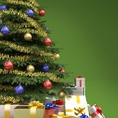 picture of close-up  - close up of decorated christmas tree with many presents on green background with copy space on right - JPG