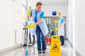 stock photo of work crew  - Commercial cleaning brigade working mopping the floor - JPG