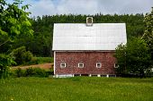 foto of red barn  - Old red barn with a metal roof - JPG