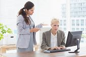 stock photo of coworkers  - Businesswoman giving orders at her coworker in an office - JPG