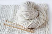 image of knitting  - Detailed photograph of white wool yarn - JPG