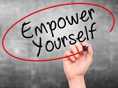 image of empower  - Man Hand writing Empower Yourself with black marker on visual screen - JPG