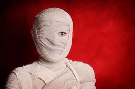 image of corpses  - woman wrapped up with bandages as a mummy halloween costume - JPG