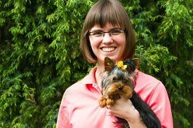 pic of juniper-tree  - happiness yarn woman with notepad and york terrier on juniper tree background  - JPG