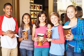 picture of pre-adolescent child  - Group Of Children Standing Outside Cinema Together - JPG