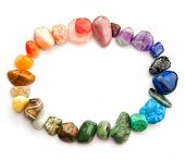 Color spectrum of semiprecious gemstones in round border, on white background