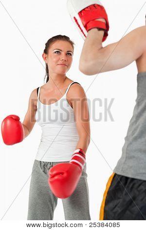 Постер, плакат: Молодая самка в боевых искусств на белом фоне, холст на подрамнике