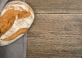 Freshly Baked Traditional Bread On Rustic Background poster