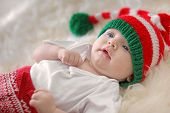 Adorable Baby In Christmas Hat On Fuzzy Rug poster