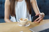 A Nice Girl With Hot Cappuccino. Blak Phone In Girl Hand poster
