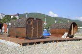A Miniature Mini Sauna On The Sea Beach. poster