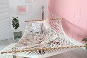 Comfortable Hammock With Plaid And Pillows In Stylish Interior poster