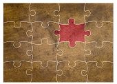 image of dtp  - copper texture of puzzle one piece in red - JPG