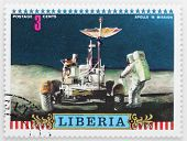 LIBERIA - CIRCA 1975: A stamp printed in Liberia shows astronaut John Young on the moon with LRV Rov