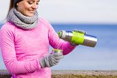 Woman Athlete Fit Girl Wearing Warm Sporty Clothes Outdoor In Cold Weather Drinking Hot Tea From Vac poster