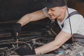 Car Mechanic Working Diagnostic Equipment At Automotive Service. poster
